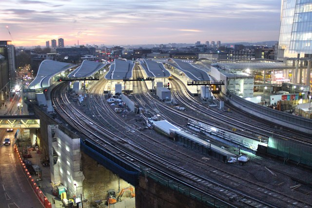 LondonBridgesunrise: The sun rises over London Bridge station, with the Shard to the right of the picture.   On 2 January 2018 the final part of the new concourse will open to the public and the new platforms 1-5 will be complete.