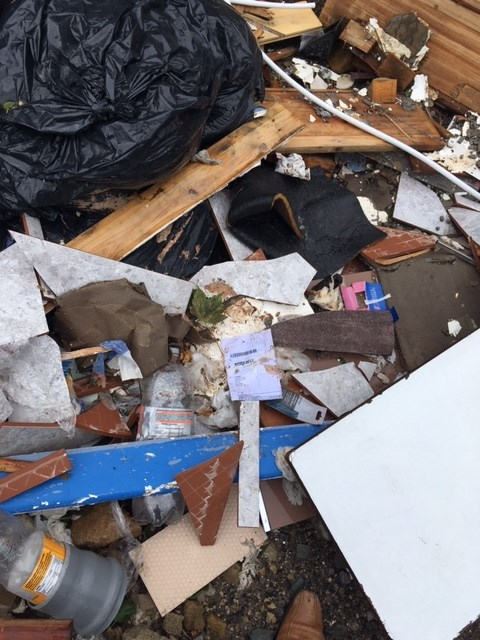 Burnley fly tipping with invoice showing