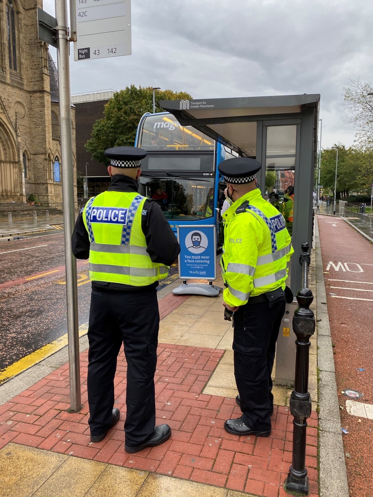 TSP DoA Oxford Rd2 2: Officers from the GMP Transport Unit waiting to board a bus on Oxford Road and ensure students are compling with social distancing and face covering regulations.