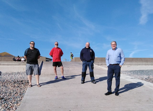 Jeffrey Hailes, Copeland Councillor for St Bees, on the far right with three RNLI volunteers.