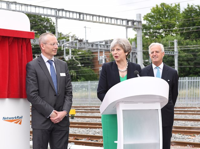 Prime Minister opens railway sidings for new electric services: Theresa May with Mark Langman (L), Network Rail Western Route MD, and Tim O'Toole (R), CEO of FirstGroup