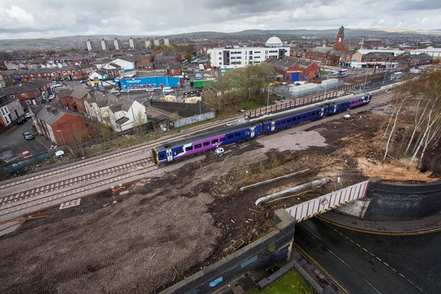 First phase of work to upgrade railway between Littleborough and Manchester Victoria completed on time: A Northern train passes over upgraded track near Rochdale station