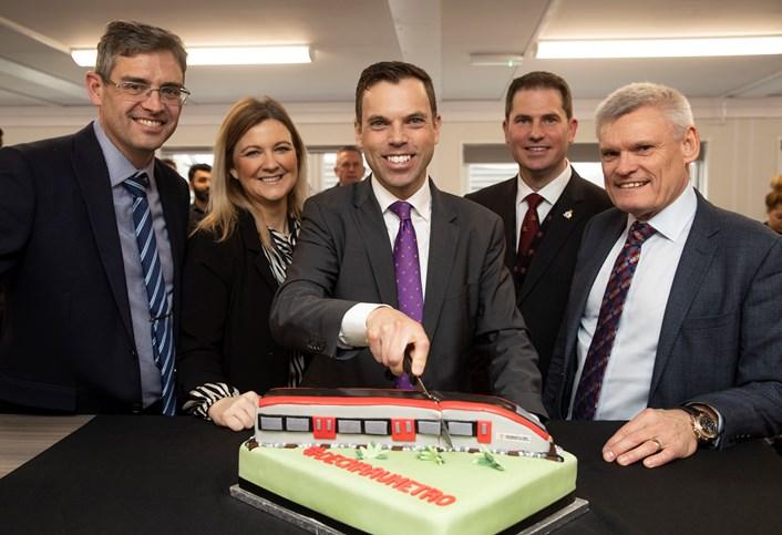 Ken Skates and team with Metro cake
