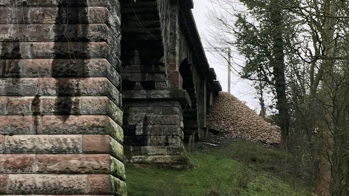 Successful emergency landslip repair reopens southbound West Coast main line to passengers a day early: 380 tonnes of stone to reinforce landslip at Dutton Viaduct near Warrington