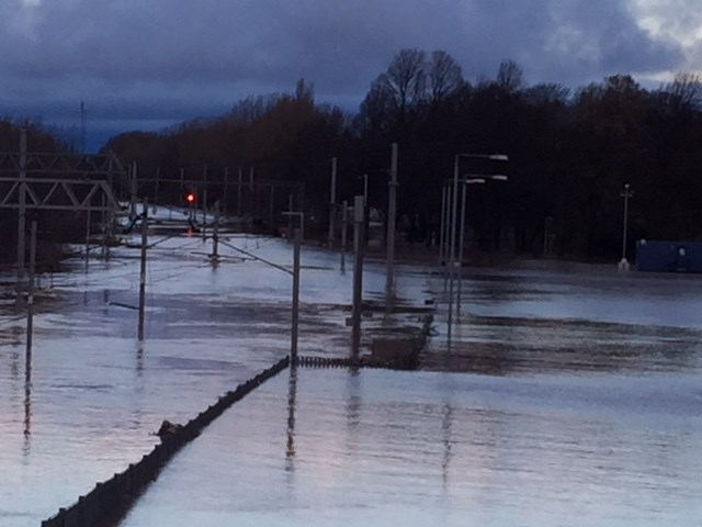 Eight foot-deep floodwater means northern section of West Coast main line to remain closed for several days: Flooding on the West Coast main line north of Carlisle