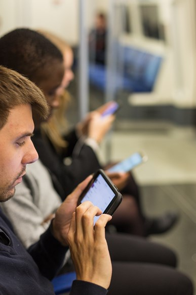 TfL Image - People using smartphones on the Jubilee line