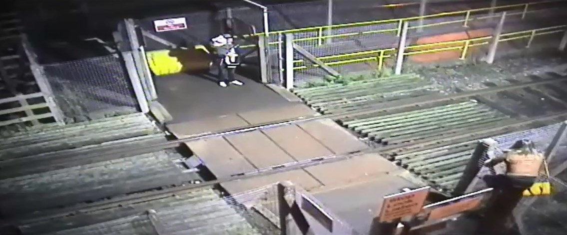 Adults risk toddler's life on railway in shocking CCTV footage: Woman climbs over locked level crossing gate