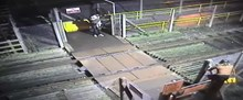 Woman climbs over locked level crossing gate
