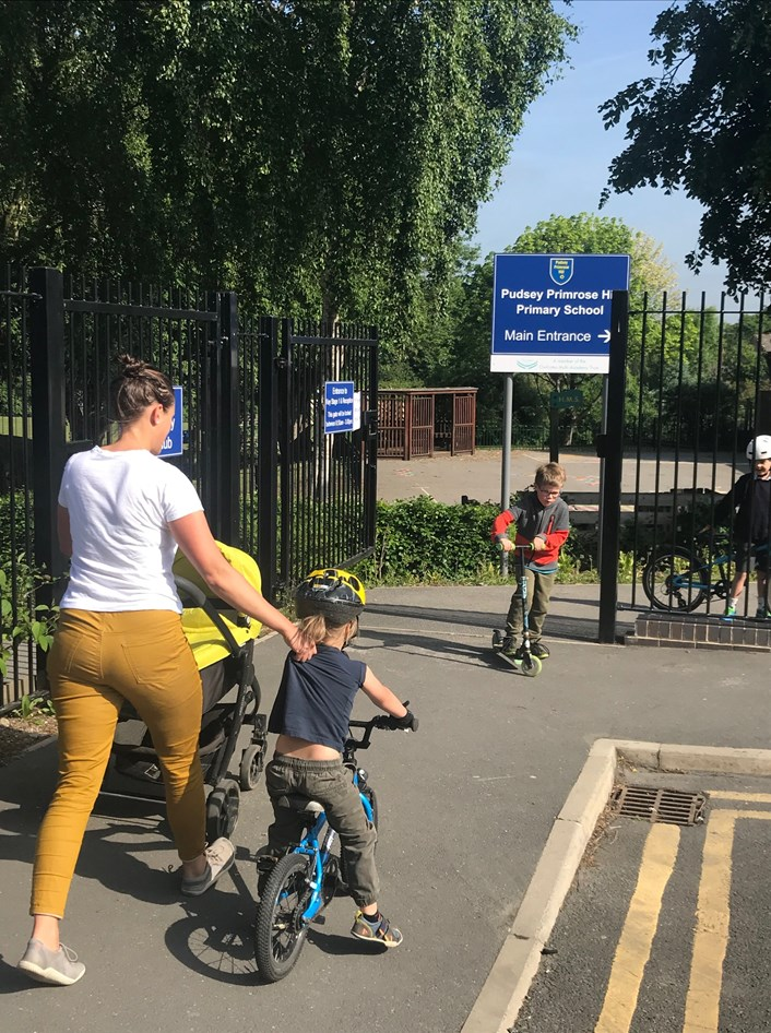 School Streets cycling family Primrose Hill Primary: Family using active travel to get to school.