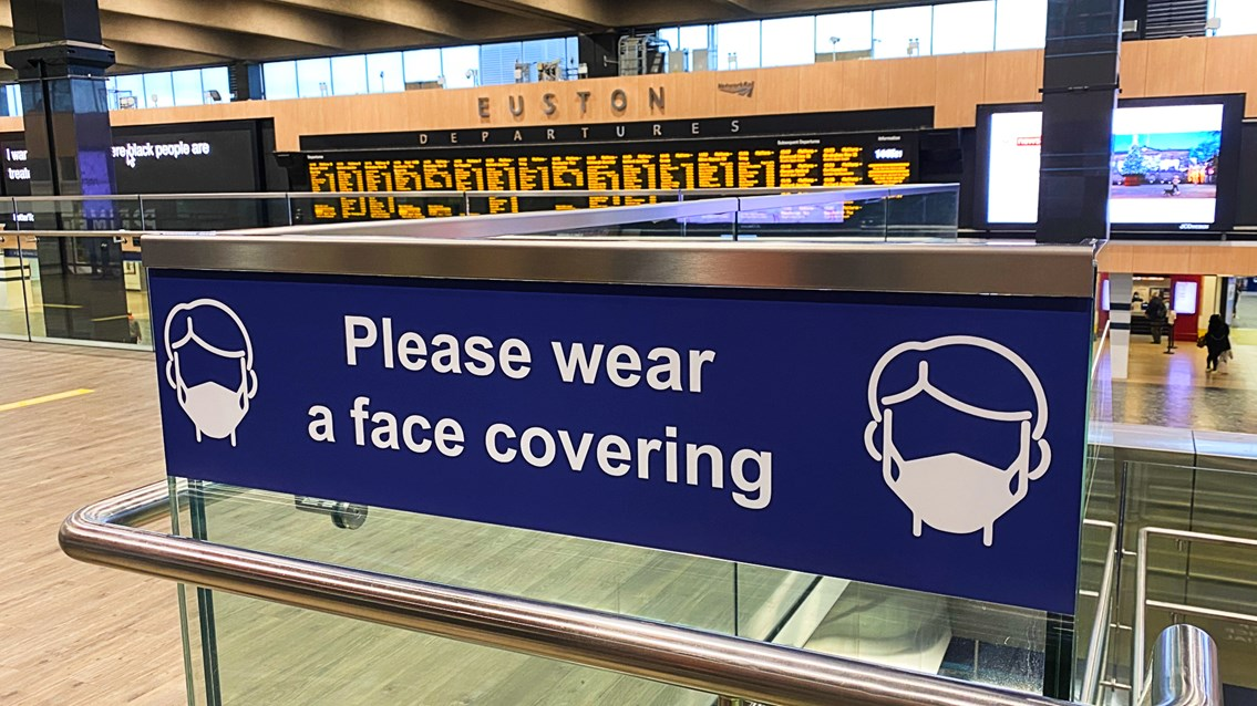 Tests show no traces of Covid-19 at four major railway stations: Euston station face covering signage stock shot