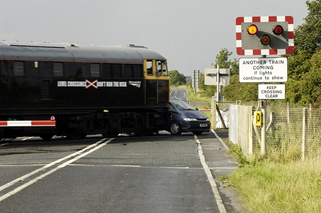 Top Gear - the collision: At a speed approaching 70mph a 107-tonne train branded with 'Level crossings: Don't run the risk' collides with car on alevel crossing in Lincs