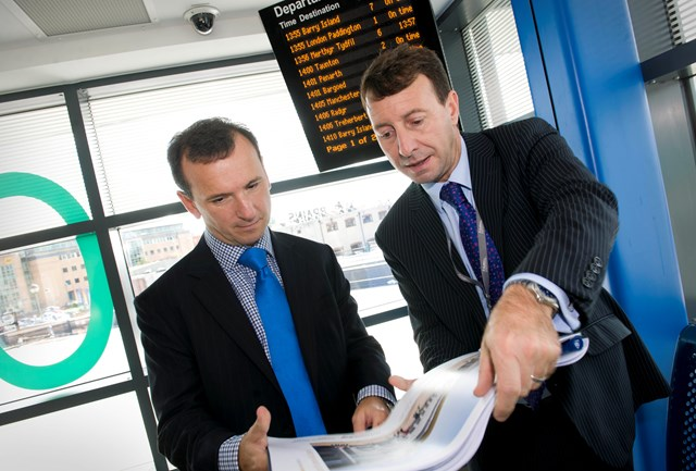 Wales Office Minister Alun Cairns with Network Rail's Tim James at Cardiff Central