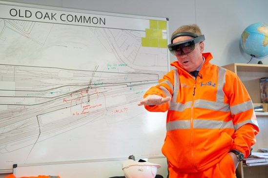 Augmented Reality at Old Oak Common Station with Mark Thurston March 2020: Credit: HS2 Ltd. Mark Thurston at Old Oak Common railway station, London, 9th March 2020. Mark Thurston, CEO HS2, visits the construction activity at the Old Oak Common site, using the augmented reality headset, being interviewed by London media and talking about plans for the Old Oak Common site Internal Asset No. 15223