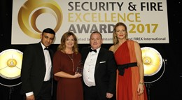 Mitie's security management team pick up the 'Best Contribution to Standards' award, presented by Gabby Logan, right.: Mitie's security management team pick up the 'Best Contribution to Standards' award, presented by Gabby Logan, right.