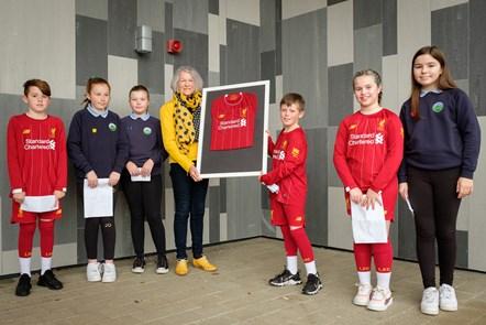 Barbara Alexander presents Liverpool strips to Jack, Chloe, Keavie, Declan, Errin and Lea