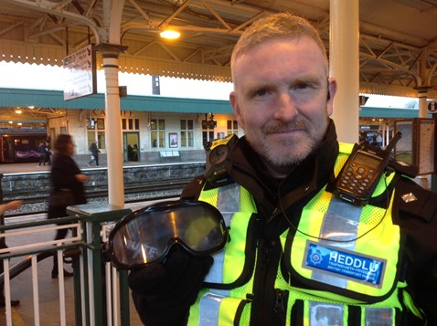 BTP Chief Inspector for Wales Mark Cleland with the 'beer goggles' passengers are being invited to try out
