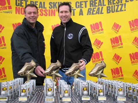DCFC president and chief executive, Tom Glick and Network Rail area general manager, Mark Tarry present trophies