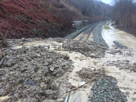 The line was closed on Sunday 21 January after heavy rain caused a landslip at Dinas Rhondda, blocking the railway line