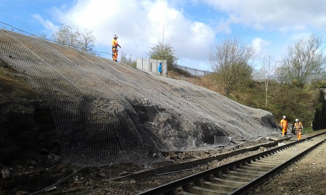 Services back on track as landslide recovery works completed: Lambhill landslip 1 - engineers installing rock netting