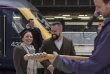 Adam surprised Kerri-Anne as she got off the train